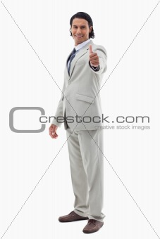 Portrait of an office worker posing with the thumb up