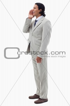 Portrait of a smiling office worker shouting