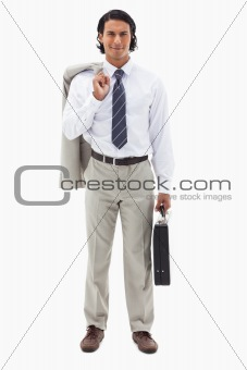 Portrait of an office worker holding his jacket over his shoulder and a briefcase