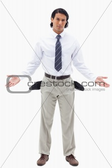 Portrait of an innocent businessman showing his empty pockets