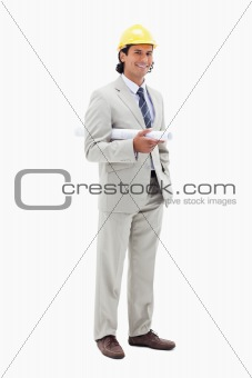 Smiling architect with helm and construction plan