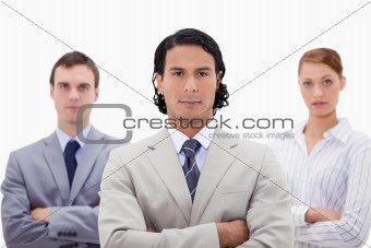 Three businesspeople with folded arms