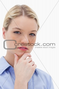 Thoughtful woman touching her chin