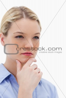 Thinking woman touching her chin