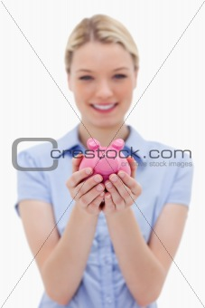 Piggy bank being held by young woman