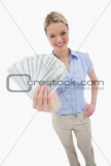 Money being held by woman