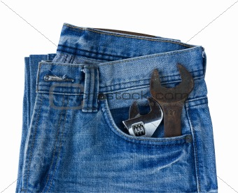 Blue jeans pocket with old tool