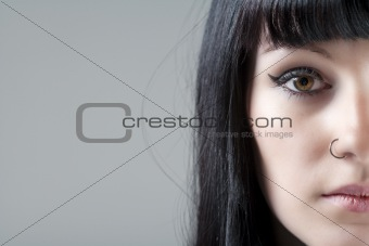 Portrait of young woman with black hair