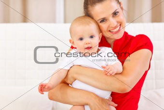 Portrait of cute baby and happy young mother