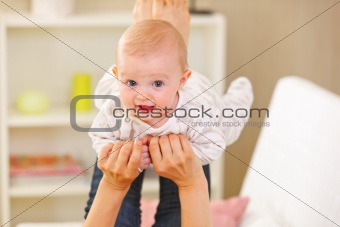 Baby playing with mother at home