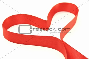 Beautiful heart from red satin ribbon