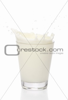 Milk splah on a glass, over white background