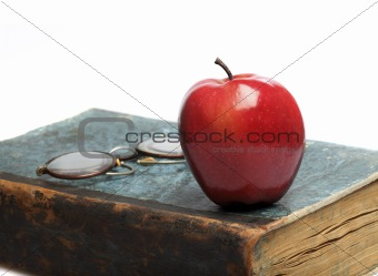 Old Book with red Apple