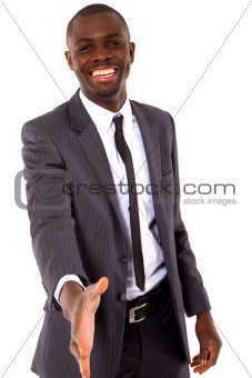businessman holds out his hand