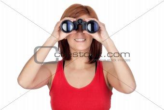 Beautiful redhead girl looking through binoculars