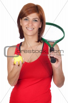 Beautiful redhead girl with a tennis racket