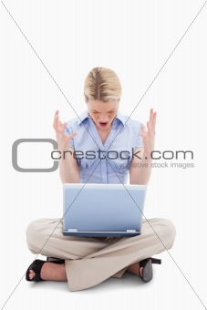 Sitting woman yelling at her laptop