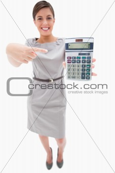 Woman pointing at hand calculator