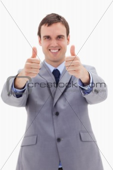 Thumbs up given by smiling businessman