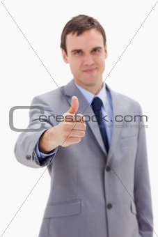 Thumb up given by businessman