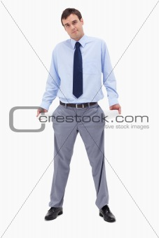 Broke businessman showing his empty pockets