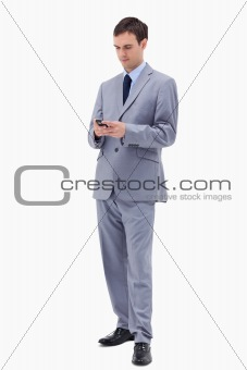 Businessman writing text message