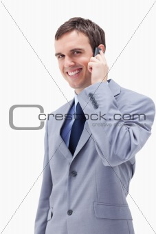 Smiling businessman on the cellphone
