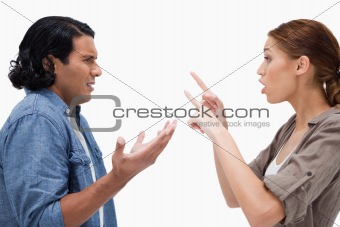 Side view of arguing couple