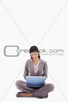 Sitting woman working with laptop
