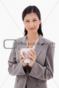 Businesswoman holding cup