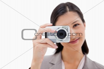 Businesswoman taking a picture