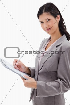 Side view of businesswoman taking notes