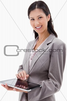 Smiling businesswoman using tablet
