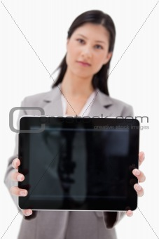 Businesswoman showing tablet screen