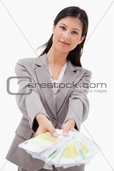 Businesswoman offering money