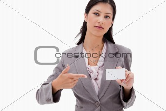 Businesswoman pointing at name badge
