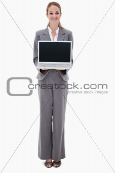 Smiling bank employee presenting her laptop