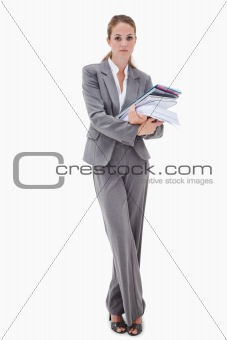 Office employee with pile of paperwork