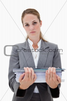 Desperate office employee with pile of paperwork