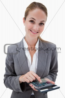 Smiling bank employee with pocket calculator