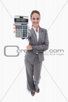 Smiling bank employee showing pocket calculator