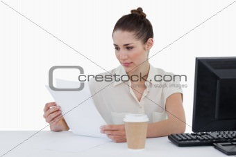 Focused businesswoman looking a document
