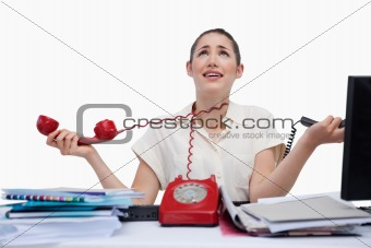 Stressed secretary answering the phones