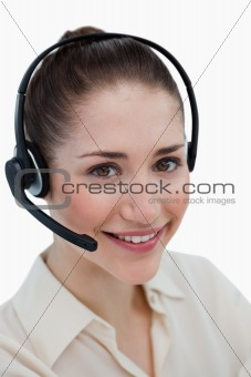 Portrait of a happy operator posing with a headset