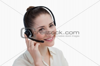Smiling operator posing with a headset