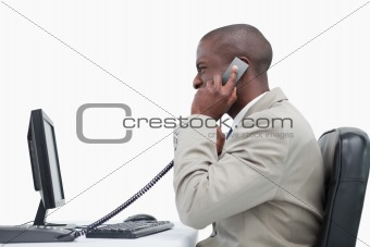 Side view of an angry businessman making a phone call