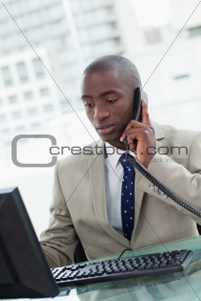 Portrait of an office worker making a phone call