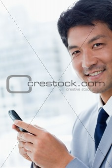 Portrait of a office worker using his mobile phone