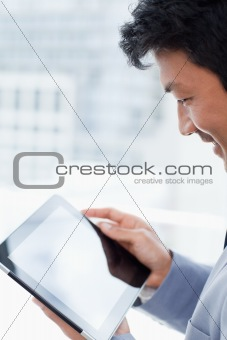 Portrait of a office worker using a tablet computer
