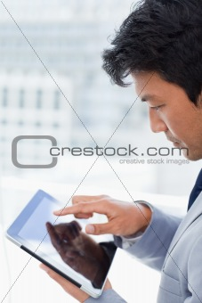 Portrait of a young office worker using a tablet computer